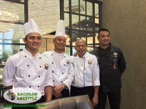 Chef Anton Abad rightmost and his team behind the Thanksgiving buffet at Vikings Bacolod